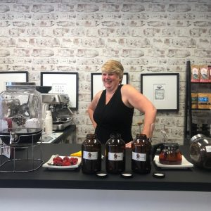 Photo of Tracy Pepe behind a counter in her shop.